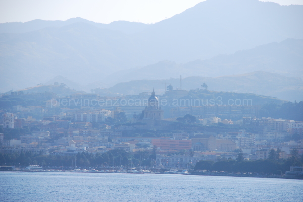 Messina, Sicily, Italy under fog as seen from sea.