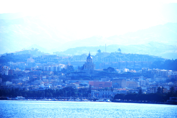 A view of Messina under fog from the sea.