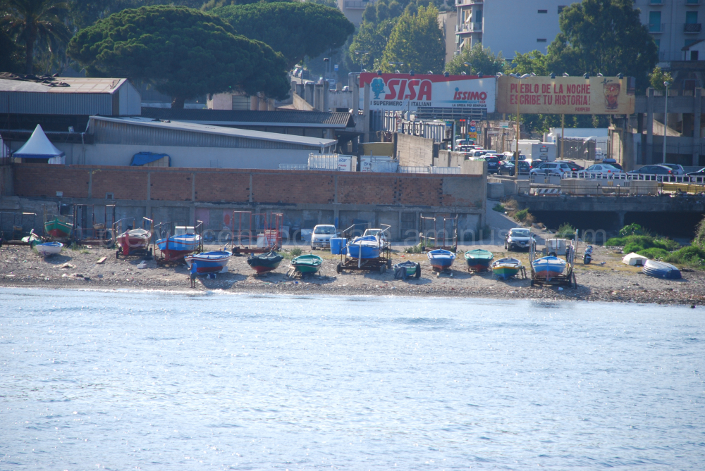 A view of ship and cars in Messina, Italy.