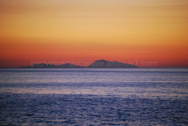 Aeolian island at sunset as seen from Calabria, IT
