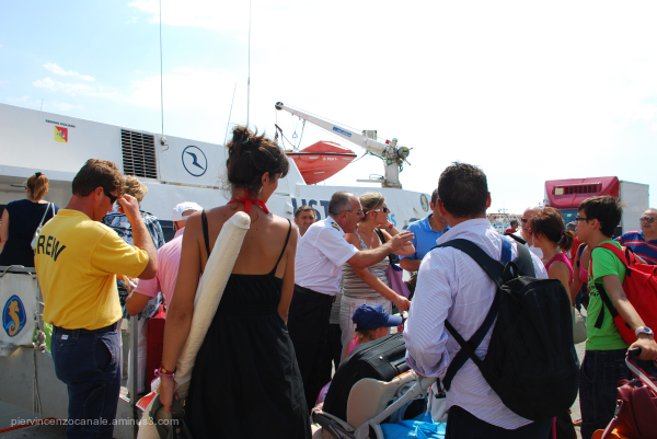 Angry crowd of holidaymakers in Porto Empedocle.