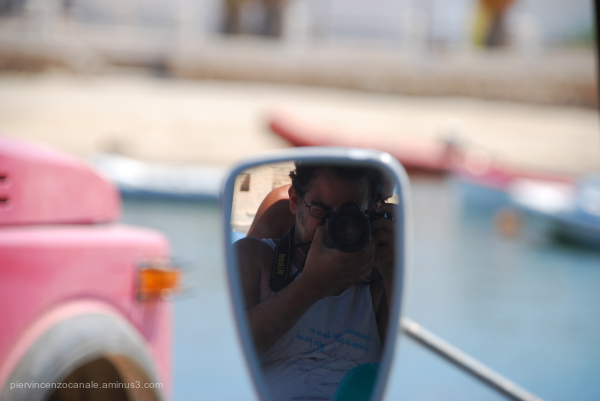 Mirroring a photographer in Lampedusa, Italy.