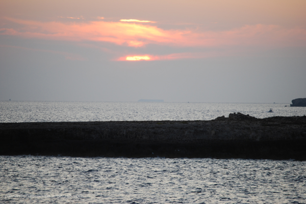 Sunset with fog and boat from Lampedusa, Italy