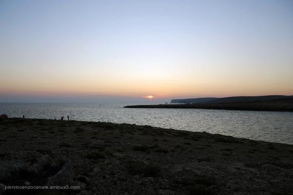 Sunset orange, blue and the landscape of Lampedusa