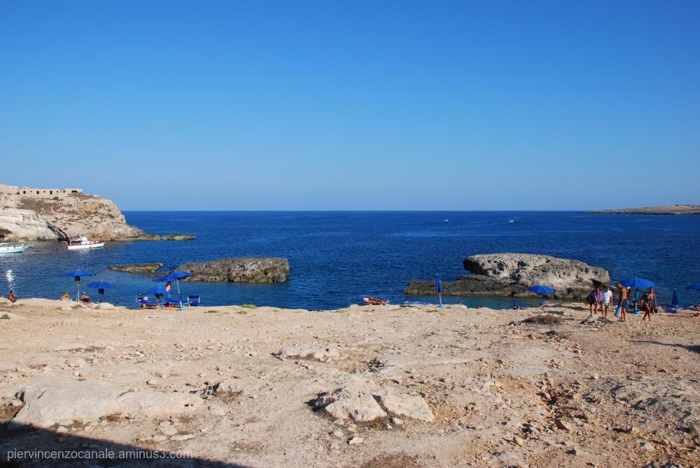 Beach on the rocks of Lampedusa, Italy.