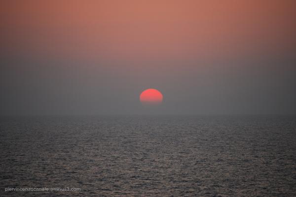 Sun sets over the sea. Lampedusa, Italy, summer.