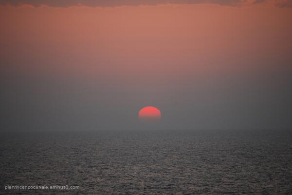 Sunset with dusk and fog. Lampedusa, summer 2009.