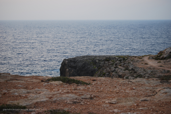 Rock of Lampedusa at sunset on a cloudy day
