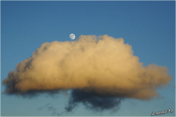 Moon on a cloud's bed