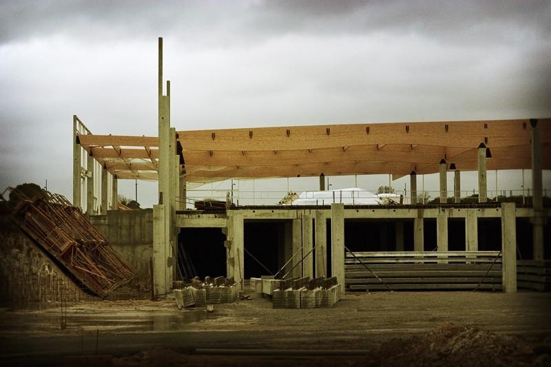 Frame of building under winter sky.