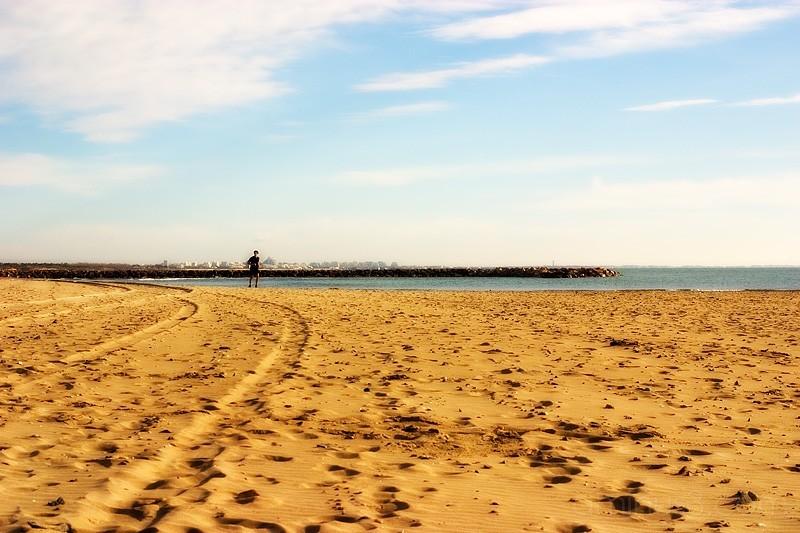 Man running on beach.