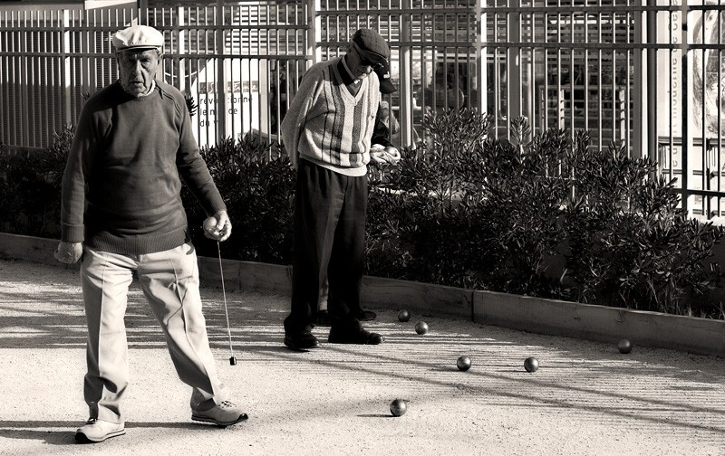 Old men playing petanque.