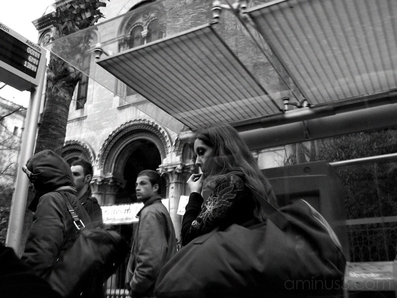People on station entering tram.