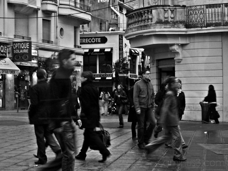Men and women walking in Montpellier, France.