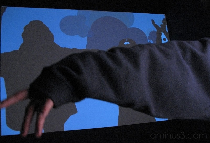 Girl projecting her image on a screen.