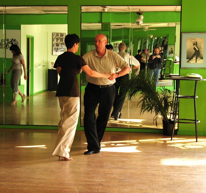 Man and woman dancing in a studio.