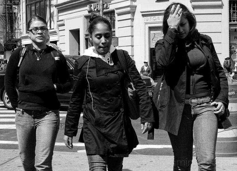Three women walking in Manhattan, New York.
