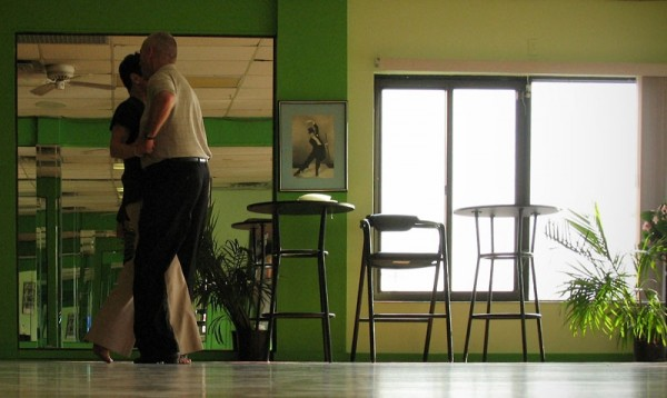 Middle aged couple in dance studio.