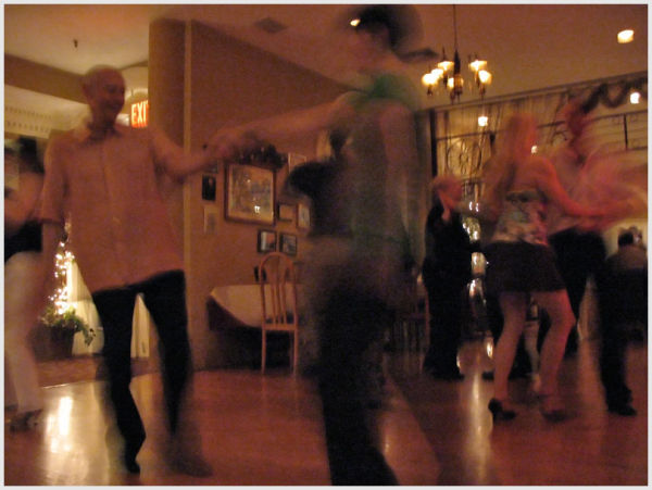 Couples dancing at a night club.