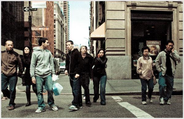 People crossing a street in Manhattan, New York.