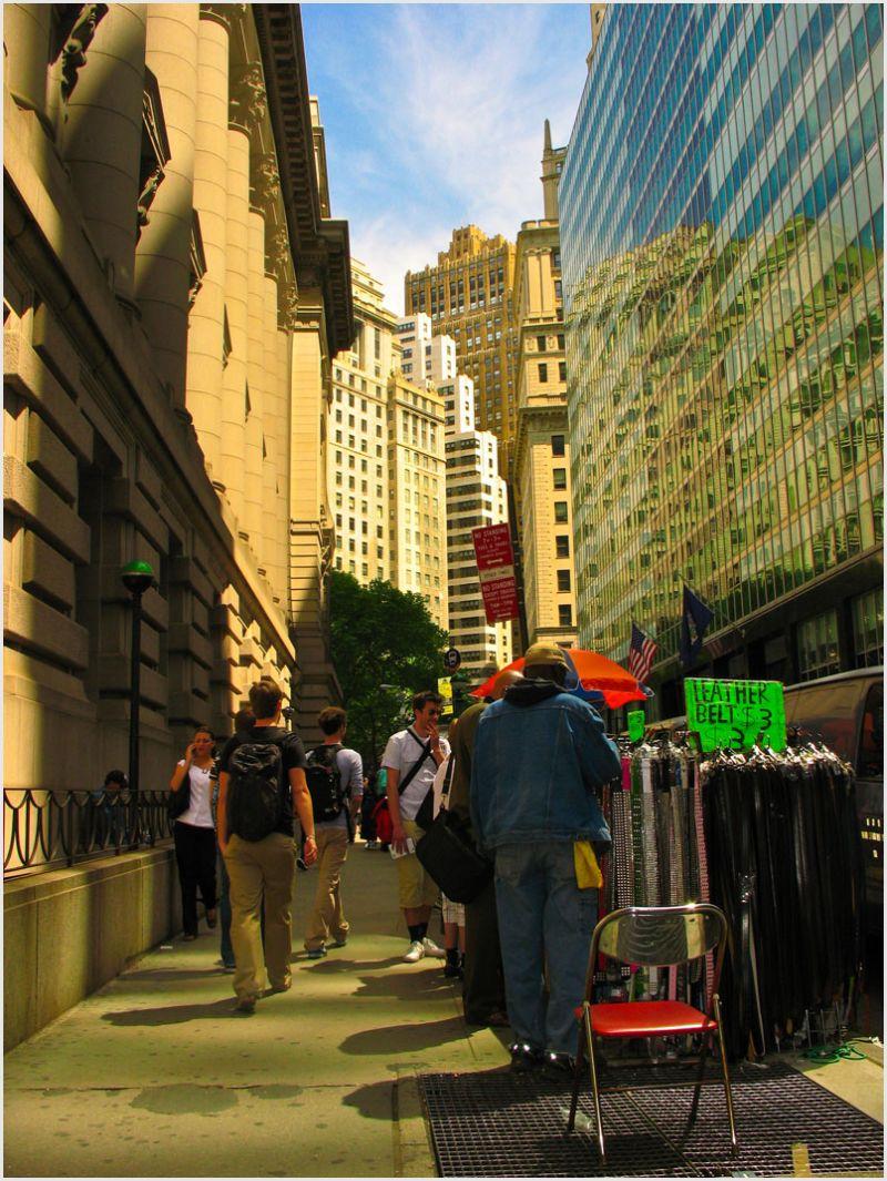 Vendor and pedestrians in lower Manhattan, NYC.