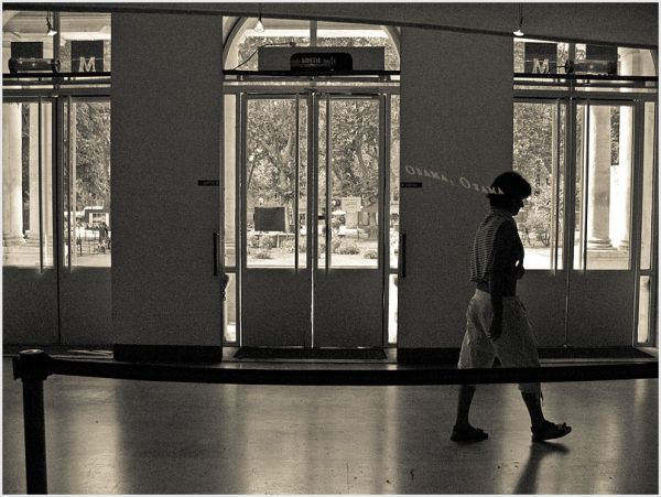 Silhouette of woman walking in a building.