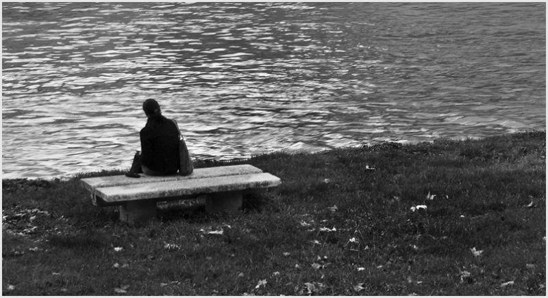 Woman sitting on a concrete bench.