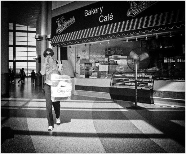 Woman walking in the ferry terminal, NYC.