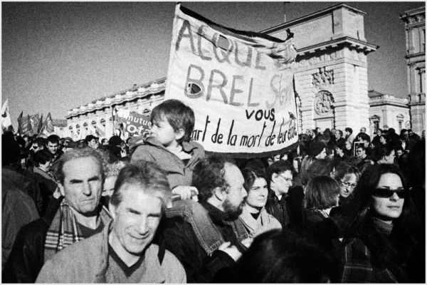 Protest march, boy on shoulders of father, France.