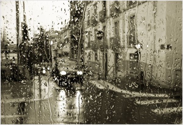 Street scene through a wet window.