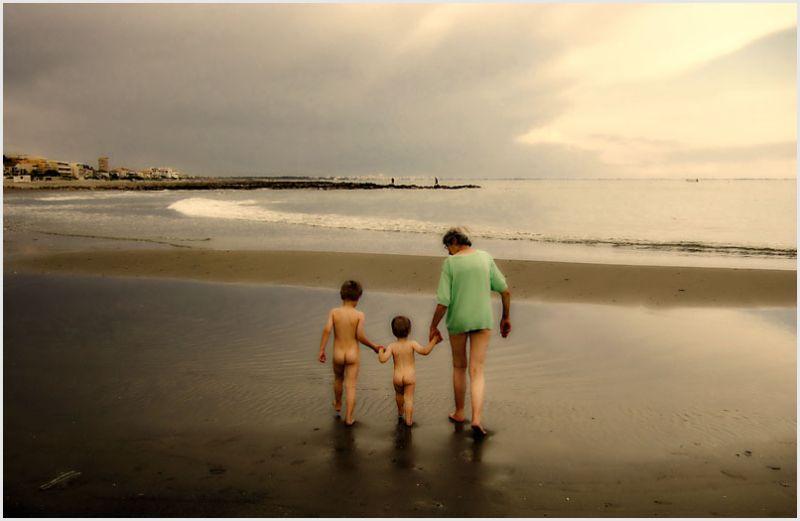 Grandma with her grandkids at the beach.
