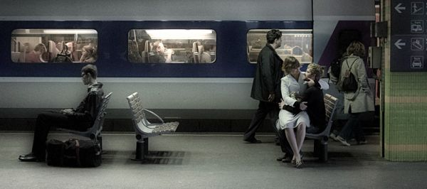 People on a train platform in the south of France.
