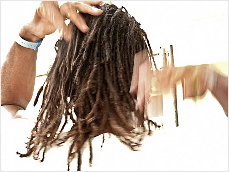 Man brushing back his hair.