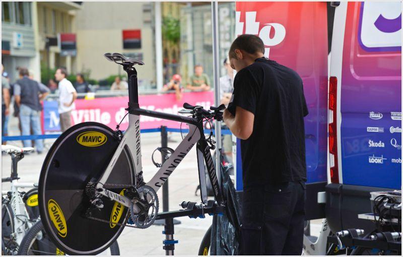 Bike mechanic working on a pro racing bike.