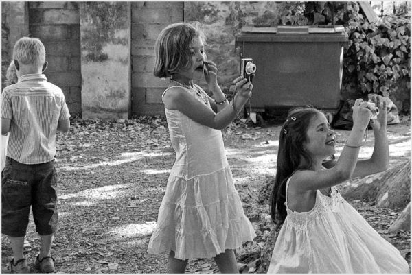 Two young girls taking pictures...