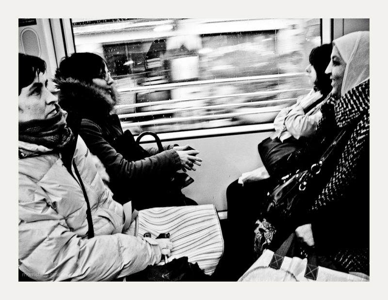 Four women on a tramway.