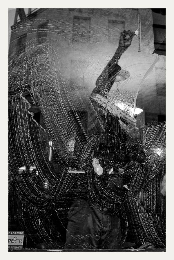 Man washing a bar window.