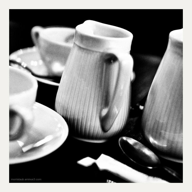 Coffee cups, milk at La Coupole in Paris