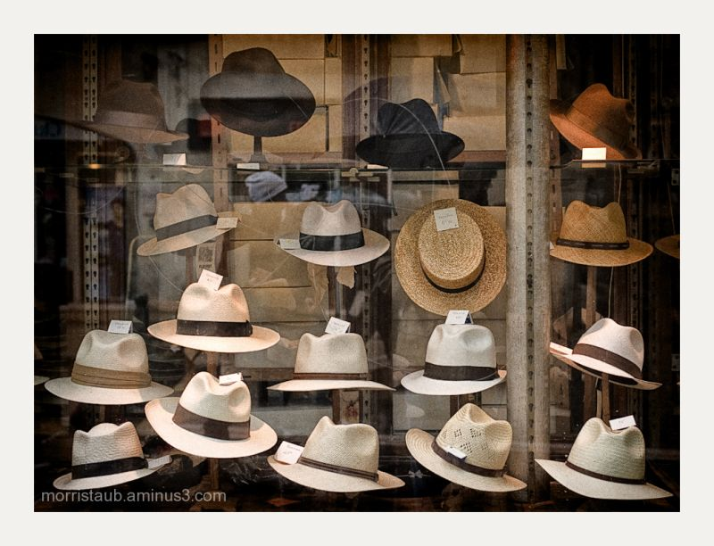 Old style hats in a window.