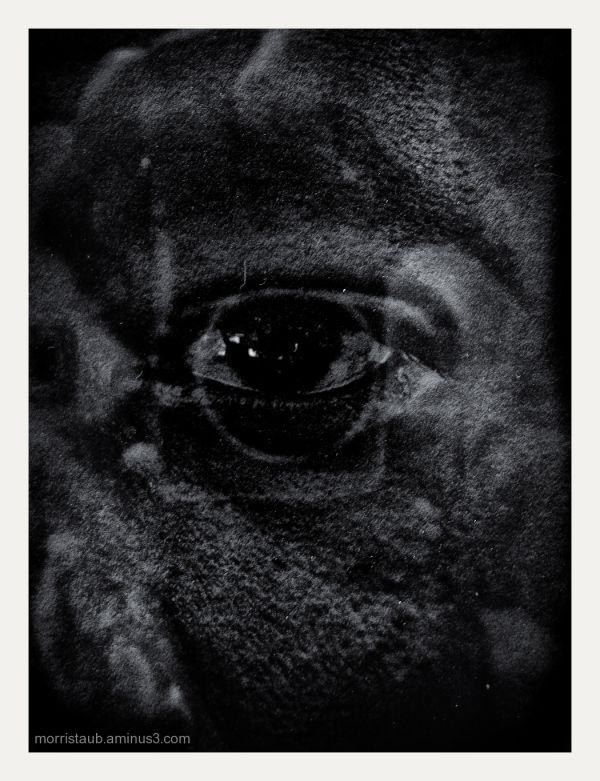 B&W eye with reflections.
