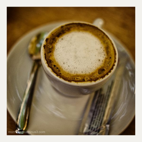 Small cup of coffee with milk in France.