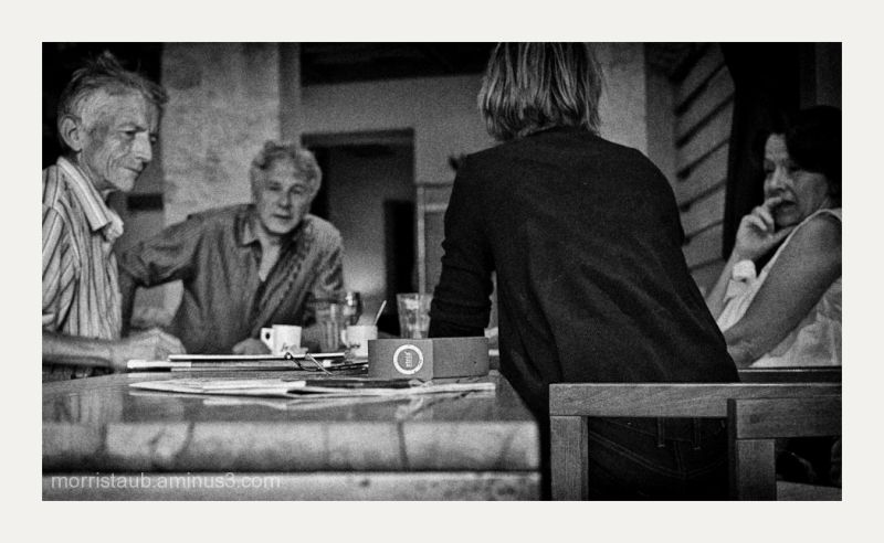 Friends talking in a cafe in France.