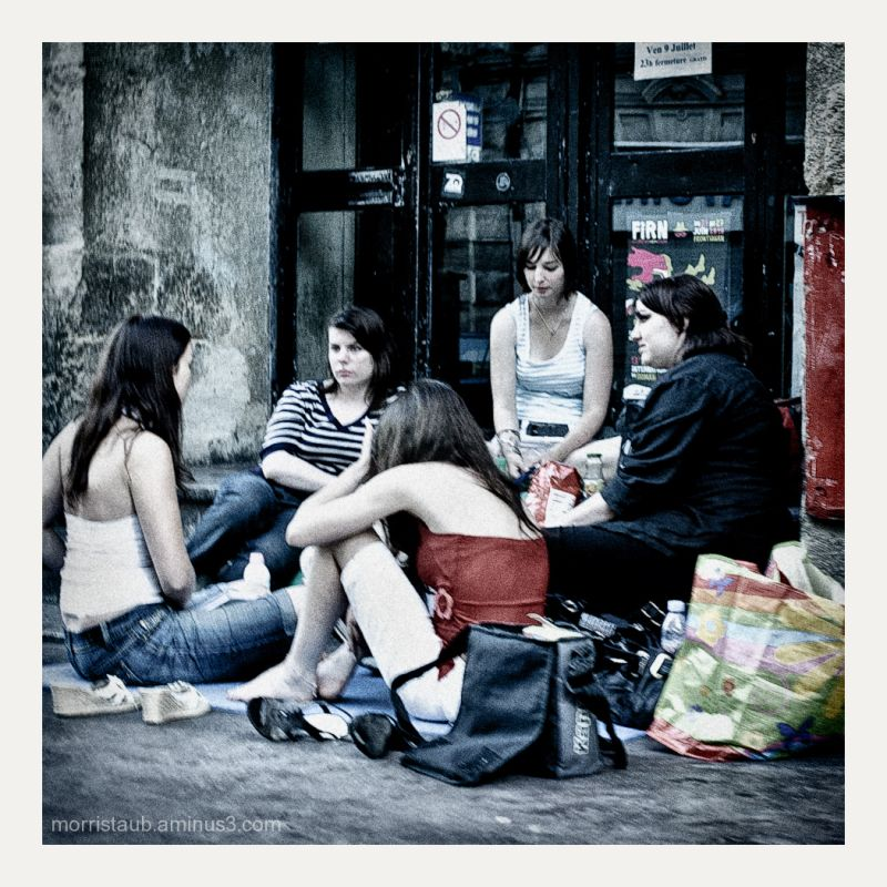 Five young women talking on the street