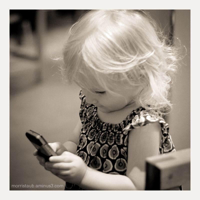 Small girl holding a cellphone.