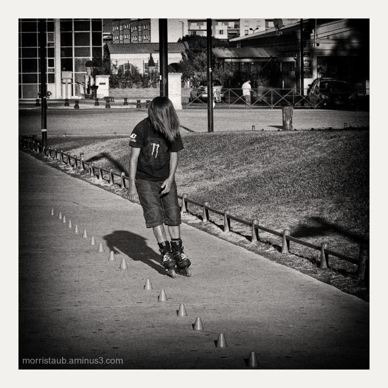 Boy rollerblading.