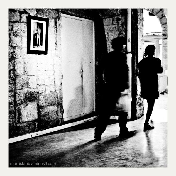 People walking in a gallery.