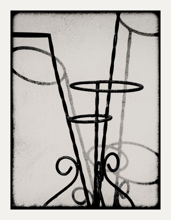 Iron plant stand and shadow.