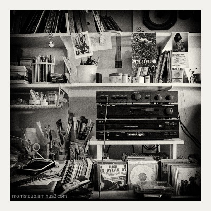 Music, brushes, and cd's in studio work space.