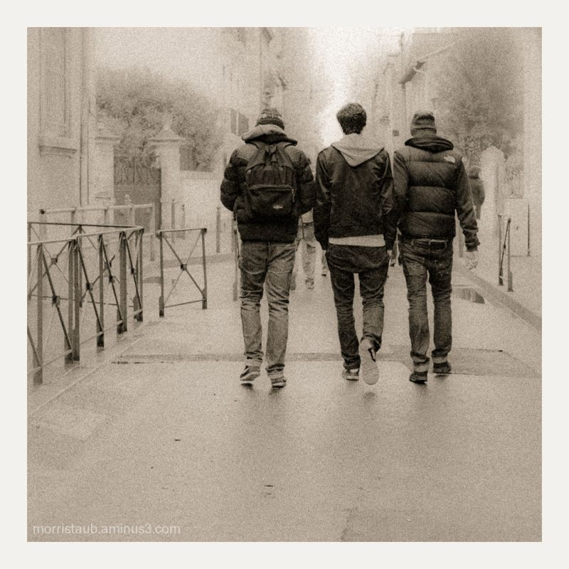 Three friends walking together.