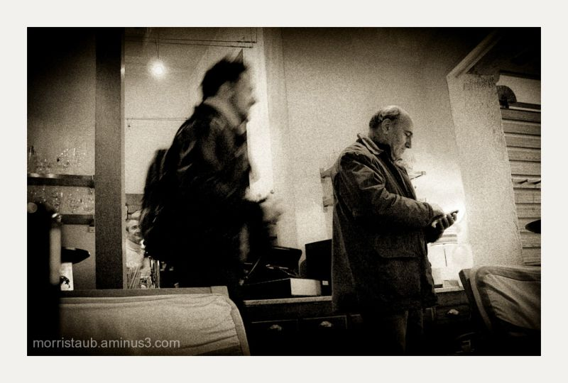 Two men in a cafe in France.